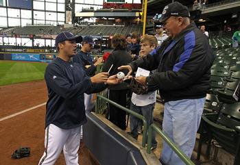 MILWAUKEE, WI - APRIL 04: Brandon Kintzler #61 of the Milwaukee Brewers signs autographs for fans before the opening day game against the Atlanta Braves at Miller Park on April 4, 2011 in Milwaukee, Wisconsin. (Photo by Jonathan Daniel/Getty Images)