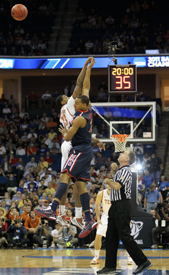 TULSA, OK - MARCH 20:  Tristan Thompson #13 of the Texas Longhorns and Derrick Williams #23 of the Arizona Wildcats go up for the game opening tip-off during the third round of the 2011 NCAA men's basketball tournament at BOK Center on March 20, 2011 in T