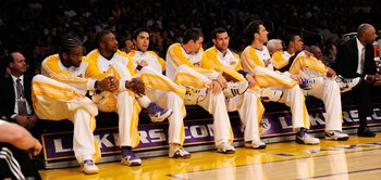 LOS ANGELES, CA - NOVEMBER 01:  Los Angeles Lakers bench, from left to right, Josh Powell, DJ Mbenga, Sasha Vujacic, Adam Morrison, Jordan Farmar, Luke Walton, and Shannon Brown cross their leg after the first point is scored by a Laker during the an NBA