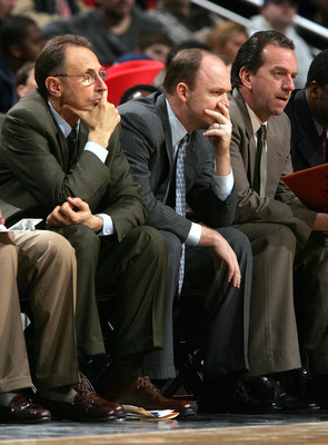 CHICAGO - MARCH 1:  Coaches (L-R) Ron Adams, Scott Skiles and Jim Boylan of the Chicago Bulls watch as the Bulls watch from the sideline during a game against the Houston Rockets on March 1, 2005 at the United Center in Chicago, Illinois. The Rockets defe