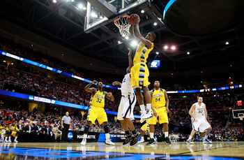CLEVELAND, OH - MARCH 18: Jimmy Butler #33 of the Marquette Golden Eagles gets a rebound against the Xavier Musketeers during the second round of the 2011 NCAA men's basketball tournament at Quicken Loans Arena on March 18, 2011 in Cleveland, Ohio.  (Phot