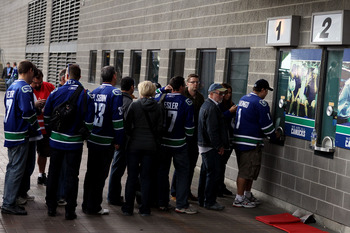 VANCOUVER, BC - JUNE 10:  Vancouver Canucks fans line up for tickets to Game Five between the Vancouver Canucks and the Boston Bruins in the 2011 NHL Stanley Cup Final at Rogers Arena on June 10, 2011 in Vancouver, British Columbia, Canada.  (Photo by Els