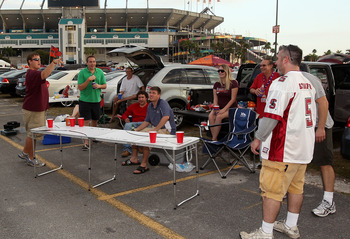 MIAMI, FL - JANUARY 03:  Fans play beer pong in the parking lot as they tailgate prior to the Stanford Cardinal playing against the Virginai Tech Hokies during the 2011 Discover Orange Bowl at Sun Life Stadium on January 3, 2011 in Miami, Florida.  (Photo