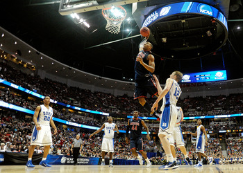 ANAHEIM, CA - MARCH 24:  Derrick Williams #23 of the Arizona Wildcats dunks the over Kyle Singler #12 of the Duke Blue Devils during the west regional semifinal of the 2011 NCAA men's basketball tournament at the Honda Center on March 24, 2011 in Anaheim,