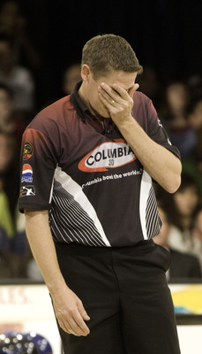 WICHITA, KS - OCTOBER 26:  Chris Barnes covers his eyes after seeing his roll against Norm Duke in the finals of the PBA World Championships held at the Northrock Lanes on October 26, 2008 in Wichita, Kansas. (Photo by Craig Hacker/Getty Images for PBA)