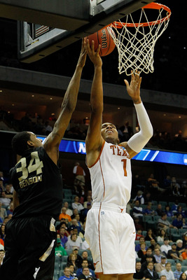 TULSA, OK - MARCH 18:  Gary Johnson #1 of the Texas Longhorns goes up for a shot as Keith Benson #34 of the Oakland Golden Grizzlies defends during the second round of the 2011 NCAA men's basketball tournament at BOK Center on March 18, 2011 in Tulsa, Okl