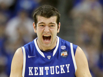 HOUSTON, TX - APRIL 02:  Josh Harrellson #55 of the Kentucky Wildcats reacts after a play against the Connecticut Huskies during the National Semifinal game of the 2011 NCAA Division I Men's Basketball Championship at Reliant Stadium on April 2, 2011 in H