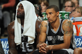DENVER, CO - MARCH 23:  DeJuan Blair #45 and George Hill #3 of the San Antonio Spurs sit on the bench against the Denver Nuggets at the Pepsi Center on March 23, 2011 in Denver, Colorado. The Nuggets defeated the Spurs 115-112. NOTE TO USER: User expressl