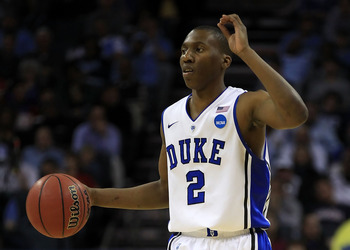 CHARLOTTE, NC - MARCH 20:  Nolan Smith #2 of the Duke Blue Devils moves the ball while taking on the Michigan Wolverines during the third round of the 2011 NCAA men's basketball tournament at Time Warner Cable Arena on March 20, 2011 in Charlotte, North C