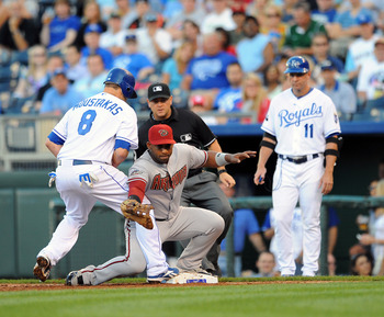 KANSAS CITY, MO - JUNE 23:  Juan Miranda #46 of#26 of the Arizona Diamondbacks can't reach an errant throw by catcher Miguel Montero during a pickoff attempt against the Kansas City Royals at Kauffman Stadium on June 23, 2011 in Kansas City, Missouri.  Al