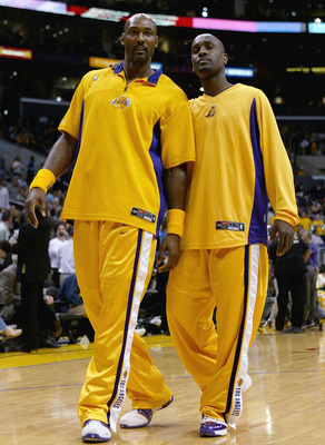 LOS ANGELES - MAY 11:  Karl Malone #11 and Gary Payton #20 of the Los Angeles Lakers talk during warmups before Game four of the Western Conference Semifinals against the San Antonio Spurs during the 2004 NBA Playoffs at Staples Center on May 11, 2004 in