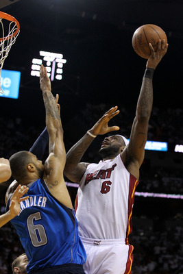MIAMI, FL - JUNE 12:  LeBron James #6 of the Miami Heat attempts a shot against Tyson Chandler #6 of the Dallas Mavericks in Game Six of the 2011 NBA Finals at American Airlines Arena on June 12, 2011 in Miami, Florida. NOTE TO USER: User expressly acknow