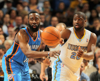 DENVER, CO - APRIL 25:  Raymond Felton #20 of the Denver Nuggets dishes the ball off against James Harden #13 of the Oklahoma City Thunder in Game Four of the Western Conference Quarterfinals in the 2011 NBA Playoffs on April 24, 2011 at the Pepsi Center