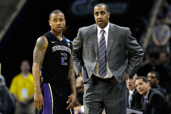 CHARLOTTE, NC - MARCH 20:  Isaiah Thomas #2 talks with head coach Lorenzo Romar of the Washington Huskies while taking on the North Carolina Tar Heels during the third round of the 2011 NCAA men's basketball tournament at Time Warner Cable Arena on March