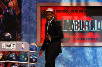 NEWARK, NJ - JUNE 23:  Kyrie Irving (R) from Duke smiles as he walks off stage after he was selected number one overall by the Cleveland Cavaliers in the first round during the 2011 NBA Draft at the Prudential Center on June 23, 2011 in Newark, New Jersey