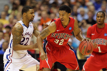 SAN ANTONIO, TX - MARCH 25:  Justin Harper #32 of the Richmond Spiders handles the ball against Marcus Morris #22 of the Kansas Jayhawks during the southwest regional of the 2011 NCAA men's basketball tournament at the Alamodome on March 25, 2011 in San A