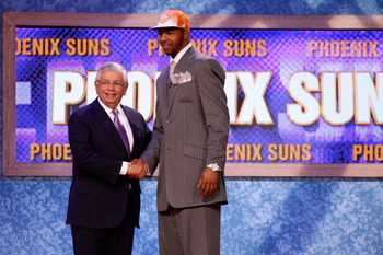 NEWARK, NJ - JUNE 23:  Markieff Morris from the Kansas Jayhawks greets NBA Commissioner David Stern after he was drafted #13 overall by the Phoenix Suns in the first round during the 2011 NBA Draft at the Prudential Center on June 23, 2011 in Newark, New