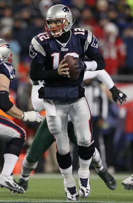 FOXBORO, MA - JANUARY 16:  Quarterback Tom Brady #12 of the New England Patriots drops back with the ball during their 2011 AFC divisional playoff game against the New York Jets at Gillette Stadium on January 16, 2011 in Foxboro, Massachusetts.  (Photo by