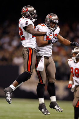 NEW ORLEANS, LA - JANUARY 02:  Larry Asante #22  and Adam Hayward #57 of the Tampa Bay Buccaneers celebrate after Asante intercepted a pass during the game against the New Orleans Saints at the Louisiana Superdome on January 2, 2011 in New Orleans, Louisi