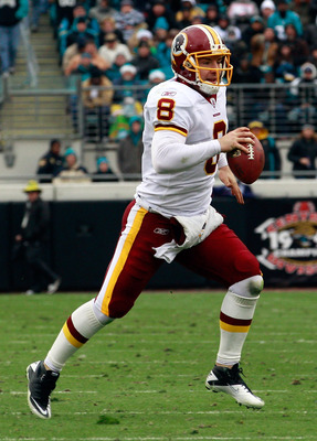 JACKSONVILLE, FL - DECEMBER 26:  Quarterback Rex Grossman #8 of the Washington Redskins scrambles for yardage during the game against the Jacksonville Jaguars at EverBank Field on December 26, 2010 in Jacksonville, Florida.  (Photo by Sam Greenwood/Getty