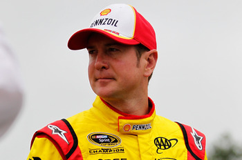 LONG POND, PA - JUNE 12:  Kurt Busch, driver of the #22 Shell/Pennzoil Dodge, stands on the grid prior to the NASCAR Sprint Cup Series 5-Hour Energy 500 at Pocono Raceway on June 12, 2011 in Long Pond, Pennsylvania.  (Photo by Geoff Burke/Getty Images for