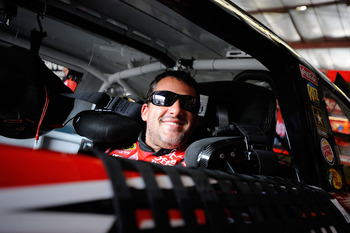 BROOKLYN, MI - JUNE 17:  Tony Stewart, driver of the #14 Office Depot/Mobil 1 Chevrolet, sits in his car during practice for the NASCAR Sprint Cup Series Heluva Good! Sour Cream Dips 400 at Michigan International Speedway on June 17, 2011 in Brooklyn, Mic