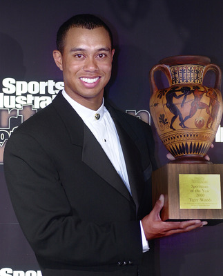 383229 01: Golfer Tiger Woods displays his Sportsman of the Year award December 12, 2000 in New York City at the Sports Illustrated Sportsman of the Year 2000 awards ceremony. (Photo by Chris Hondros/Newsmakers)