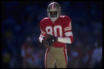 12 Nov 1995: Wide receiver Jerry Rice #80 of the San Francisco 49ers carries the ball down the field of Texas Stadium in Irving, Texas, for a big game against the Dallas Cowboys. The 49ers defeated the Cowboys 38-20.