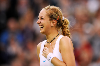 LONDON, ENGLAND - JUNE 23:  Sabine Lisicki of Germany celebrates after winning her second round match against Na Li of China on Day Four of the Wimbledon Lawn Tennis Championships at the All England Lawn Tennis and Croquet Club on June 23, 2011 in London,