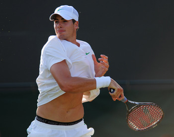 LONDON, ENGLAND - JUNE 21:  John Isner of the United States in action during first round match against Nicolas Mahut of France on Day Two of the Wimbledon Lawn Tennis Championships at the All England Lawn Tennis and Croquet Club on June 21, 2011 in London