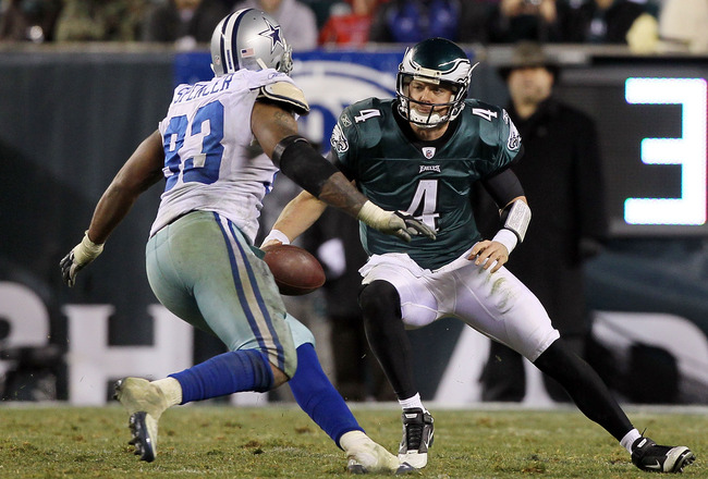 PHILADELPHIA, PA - JANUARY 02:  Kevin Kolb #4 of the Philadelphia Eagles tries to avoid a sack from Anthony Spencer #93 of the Dallas Cowboys on January 2, 2011 at Lincoln Financial Field in Philadelphia, Pennsylvania. The Cowboys defeated the Eagles 14-1