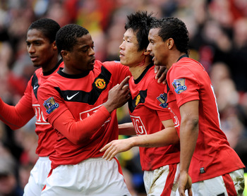 MANCHESTER, ENGLAND - MARCH 21:  Ji-Sung Park (2nd R) of Manchester United celebrates with team mates (L-R) Antonio Valencia, Patrice Evra and Nani after scoring the winning goal during the Barclays Premier League match between Manchester United and Liver