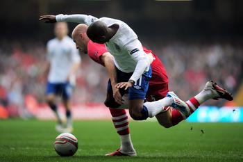 CARDIFF, WALES - MARCH 26:  Ashley Young of England is brought down by James Collins of Wales to win a penalty during the UEFA EURO 2012 Group G qualifying match between Wales and England at the Millennium Stadium on March 26, 2011 in Cardiff, Wales.  (Ph