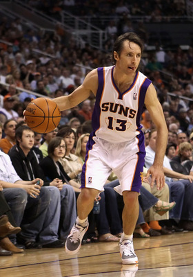 PHOENIX, AZ - MARCH 30:  Steve Nash #13 of the Phoenix Suns handles the ball during the NBA game against the Oklahoma City Thunder at US Airways Center on March 30, 2011 in Phoenix, Arizona.  The Thunder defeated the Suns 116-98. NOTE TO USER: User expres