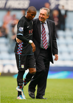 LONDON, ENGLAND - APRIL 16:  Ashley Young of Aston Villa and Aston Villa manager Gerard Houllier celebrate victory in the Barclays Premier League match between West Ham United and Aston Villa at the Boleyn Ground on April 16, 2011 in London, England.  (Ph