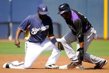 PHOENIX, AZ - MARCH 10:  Rickie Weeks #23 of the Milwaukee Brewers gets the out on Willy Taveras #3 of the Colorado Rockies during spring training baseball game at Maryvale Baseball Park on March 10, 2011 in Phoenix, Arizona.  (Photo by Kevork Djansezian/
