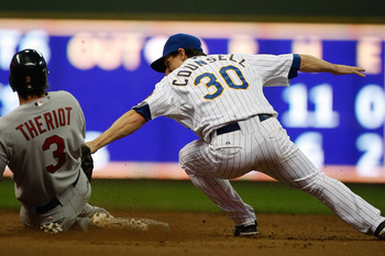 MILWAUKEE, WI - JUNE 10: Ryan Theroit #3 of the St. Louis Cardinals slides as Craig Counsell #30 of the Milwaukee Brewers applies the tag at Miller Park on June 10, 2011 in Milwaukee, Wisconsin. (Photo by Scott Boehm/Getty Images)
