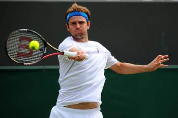 LONDON, ENGLAND - JUNE 22:  Mardy Fish of the United States returns shot during his second round match against Denis Istomin of Uzbekistan on Day Three of the Wimbledon Lawn Tennis Championships at the All England Lawn Tennis and Croquet Club on June 22,