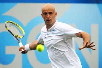 LONDON, ENGLAND - JUNE 06:  Ivan Ljubicic of Croatia eyes the ball during his Men's Singles first round match against Ryan Sweeting of the United States on day one of the AEGON Championships at Queens Club on June 6, 2011 in London, England.  (Photo by Ju