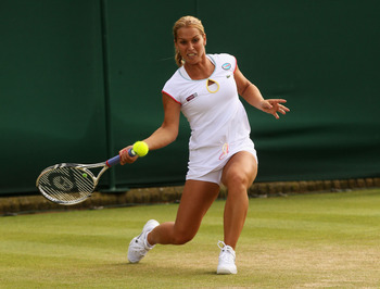 LONDON, ENGLAND - JUNE 22:  Dominika Cibulkova of Slovakia lines up a shot during her first round match against Mirjana Lucic of Coatia on Day Three of the Wimbledon Lawn Tennis Championships at the All England Lawn Tennis and Croquet Club on June 22, 201