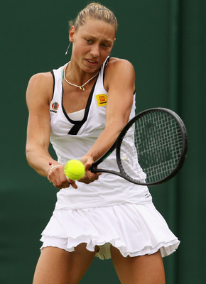 LONDON, ENGLAND - JUNE 20:  Yanina Wickmayer of Belgium returns a shot during her first round match against Varvara Lepchenko of the United States on Day One of the Wimbledon Lawn Tennis Championships at the All England Lawn Tennis and Croquet Club on Jun