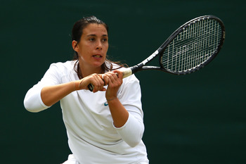 LONDON, ENGLAND - JUNE 24:  Marion Bartoli of France in action during her second round match against Lourdes Dominguez Lino of Spain on Day Five of the Wimbledon Lawn Tennis Championships at the All England Lawn Tennis and Croquet Club on June 24, 2011 in