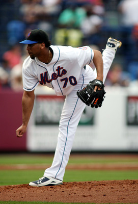 PORT ST. LUCIE, FL - FEBRUARY 26:  Pitcher Pedro Beato #70 of the New York Mets throws against the Atlanta Braves at Digital Domain Park on February 26, 2011 in Port St. Lucie, Florida.  (Photo by Marc Serota/Getty Images)
