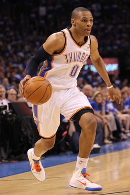 OKLAHOMA CITY, OK - MAY 21:  Russell Westbrook #0 of the Oklahoma City Thunder moves the ball while taking on the Dallas Mavericks in Game Three of the Western Conference Finals during the 2011 NBA Playoffs at Oklahoma City Arena on May 21, 2011 in Oklaho
