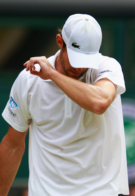 LONDON, ENGLAND - JUNE 24:  Andy Roddick of the United States wipes his face during his third round match against Feliciano Lopez of Spain on Day Five of the Wimbledon Lawn Tennis Championships at the All England Lawn Tennis and Croquet Club on June 24, 2