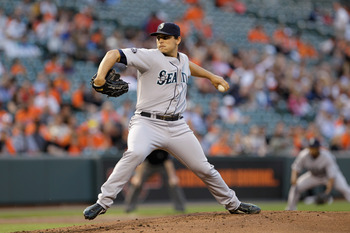 BALTIMORE, MD - MAY 12:  Starting pitcher Jason Vargas #38 of the Seattle Mariners delivers to a Baltimore Orioles batter at Oriole Park at Camden Yards on May 12, 2011 in Baltimore, Maryland.  (Photo by Rob Carr/Getty Images)