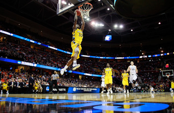 CLEVELAND, OH - MARCH 18: Jimmy Butler #33 of the Marquette Golden Eagles goes up for a dunk against the Xavier Musketeers during the second round of the 2011 NCAA men's basketball tournament at Quicken Loans Arena on March 18, 2011 in Cleveland, Ohio.  (