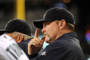 SEATTLE, WA - JUNE 1:  Eric Wedge, manager of the Seattle Mariners signals during the game against the Baltimore Orioles at Safeco Field on June 1, 2011 in Seattle, Washington. The Baltimore Orioles defeated the Seattle Mariners, 2-1. (Photo by Rod Mar/Ge
