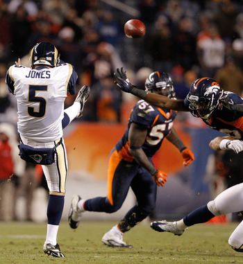DENVER - NOVEMBER 28:  Safety David Bruton #30 of the Denver Broncos blocks a punt by punter Donnie Jones #5 of the St. Louis Rams during the fourth quarter at INVESCO Field at Mile High on November 28, 2010 in Denver, Colorado. The Rams defeated the Bron