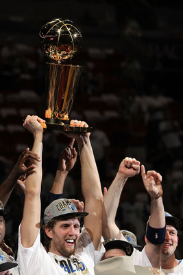 MIAMI, FL - JUNE 12:  Dirk Nowitzki #41 of the Dallas Mavericks holds up the Larry O'Brien Championship trophy after the Mavericks won 105-95 against the Miami Heat in Game Six of the 2011 NBA Finals at American Airlines Arena on June 12, 2011 in Miami, F